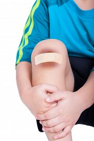 picture of bruises  - Child knee with a plaster  - JPG