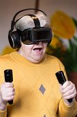 Постер, плакат: Elderly Woman With Gaming Simulator