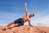 Young man doing yoga outdoors