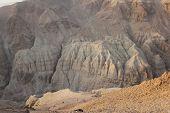 Cliffs Dragot in the Judea Desert. Salt and rocks at Dead Sea, Israel