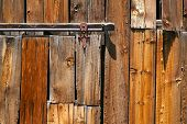 Close-up of old barn door wood and railing.