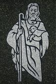 stock photo of the lost sheep  - jesus the good shepherd etched in stone in a cemetery holding sheep and staff - JPG