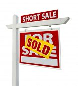 Sold Short Sale Home For Sale Real Estate Sign Isolated on a White Background with Clipping Paths - Right Facing.