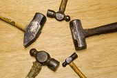 image of peen  - five old hammers showing hard use on brown background with room for logo or text - JPG