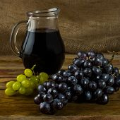 Постер, плакат: Bunch Of Grapes And Wine Jug