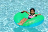 Girl in a pool floating on a tube