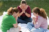 A group of teen girls gathered for prayer.