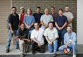 Technical college class photo of a group of handsome blue collar working men.  Diverse ages and ethnicities represented.