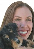 picture of poo  - young girl with cute yorkie poo puppy close to face hugging dog - JPG