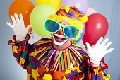 Funny birthday clown in hilarious oversized sunglasses.
