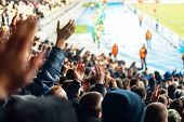 Football Fans Clapping On The Podium Of The Stadium poster