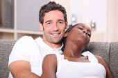 Mixed race couple relaxing on the sofa
