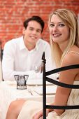 man and woman dining at a restaurant