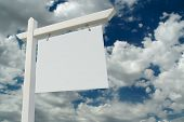 Blank Real Estate Sign On Clouds & Sky Background