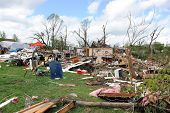 SAINT LOUIS, MO - APRIL 22: Clean up after the destruction left behind by tornadoes that ravaged the