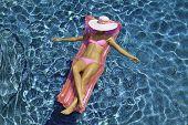 teenage girl floating on a raft