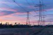 Industrial Background Group Silhouette Of Transmission Towers Sunset poster