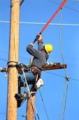 picture of lineman  - an electrical lineman working on a line - JPG