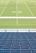 Football Stadium With Empty Seats Looking at 50 Yard Line Marker, no people