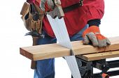 Construction Worker Cutting Board with hand saw isolated over white