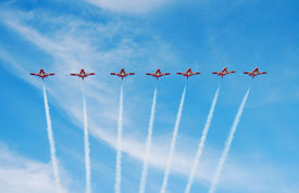 foto of snowbird  - The Snowbirds flying their airplanes gracefully overhead in sequence - JPG