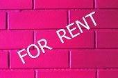Concept Rent. Inscription For Rent On A Brick Wall, Pink Color, Neon. Business And Finance. Neon Bac poster