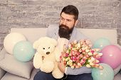 Romantic Man With Flowers And Teddy Bear Sit On Couch With Air Balloons Waiting Girlfriend. Romantic poster