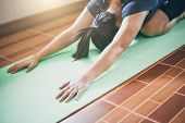 Young Woman Meditation While Practicing Yoga Indoor. Woman Exercising Vital And Meditation For Fitne poster