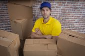 Brazilian Mailman With Arms Crossed In A Deposit With A A Lot Of Boxes. poster