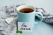 Cold And Flu Season. Cup With Hot Tea, Mint, Thermometer And Tablets On A Light Background. Treatmen poster