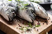 Mediterranean Fish Bream With Spices Salt Herbs Garlic And Lemon. Healthy Seafood. Concept Of Health poster