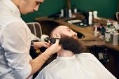 Adult Client Man In Hairdresser Chair Throwing Back His Head During Barber Styling Clients Beard Wit poster