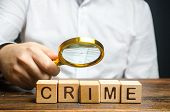 Man With A Magnifying Glass Examines The Word Crime. Investigation. Collection Evidence, Identificat poster