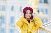 Stereo Sound. Child Girl Autumn Outfit Enjoying Music. Awesome Sound. Girl Kid With Headphones Urban poster