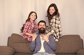 Friendly Family Having Fun Together. Mom Dad And Daughter Relaxing On Couch. Happy Parenthood. Close poster