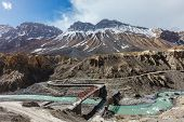 Bridge over Spiti river in Himalayas. Spiti Valley. Himachal Pradesh, India poster