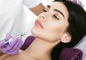 Cosmetic Face Treatment. Beautiful Mid Aged Woman Getting Face Injection, Lifting Effect, Beauty Inj poster