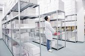 medical factory  supplies storage indoor with workers people