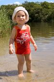 Little Barefooted Baby Boy On The River-Bank