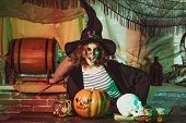 Funny With Witch Skull On Halloween Decorations Background. Halloween Party With Child Wearing Hallo poster
