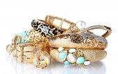 stock photo of precious stones  - Beautiful golden bracelets and rings isolated on white - JPG