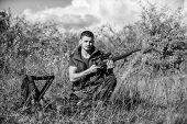 Hunting Equipment And Safety Measures. Man With Rifle Hunting Equipment Nature Background. Prepare F poster