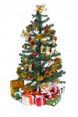 decorated Christmas tree with heap of gifts on white background