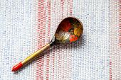 Old Russian  Traditional  Wooden Spoon  Lie On An Old Traditional Carpet. Russian Traditions. Decora poster