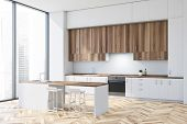 Corner Of Modern Kitchen With White Walls, Wooden Floor, White Countertops, Wooden Cupboards And Whi poster