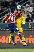 CARSON, CA. - 9 de abril: Chivas USA M Marcos Mondaini #23 (L) & Columbus Crew D Sebastián Miranda #21