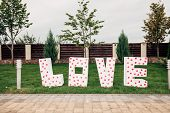 inscription love in capital letters poster