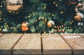 Blurred Gold Garland As Background And Wooden Tabletop As Foreground. Christmas Abstract. Image For  poster
