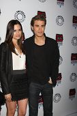 LOS ANGELES - APR 12:  Torrey DeVitto, Paul Wesley arrives at Warner Brothers