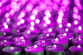 Purple Pink Candle Light. Christmas Or Diwali Celebration Tealight Candlelight. Lit Candles At Night poster